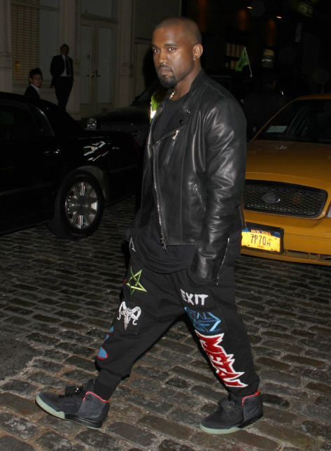 Kanye West showed up to the Versace Store opening rocking a really dope leather jacket and an interesting pair of pants